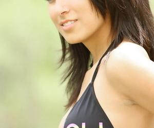 Pretty dark haired Rachel posing seductively outdoors wearing a black bikini