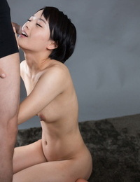 Cute little Asian girl gets on her knees naked to suck cock for a mouthful