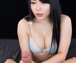 Beautiful Japanese female uncovers her tits before tugging on a cock
