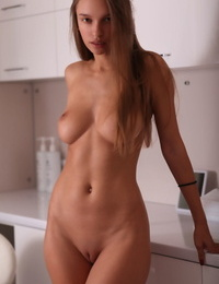 Young solo girl Elin frees her hard body from all clothing to pose naked