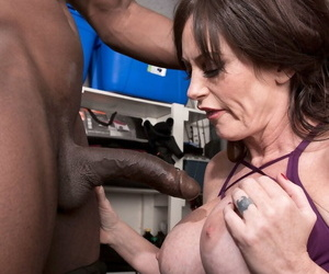 Busty middle-aged woman Sherry Stunns gets mouth fucked by her trainers BBC