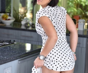 Dark haired housewife Ryder Skye bakes cupcakes and poses nude at same time