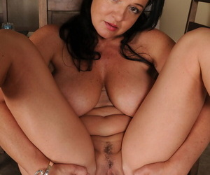 Brunette Pepper Ann drops her pants & stretches pussy wide with bare big tits