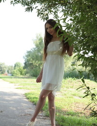 Beautiful teen Valery Leche steps out of her dress to model totally naked