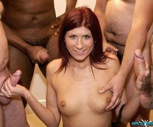 Redhead slut Anastasia takes numerous facial cumshots at a bukkake party