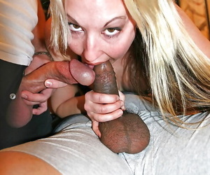 Zoe Matthews sucks off two hard cocks and receives a double facial cumshot