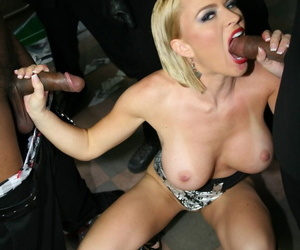 Blonde doll Krissy Lynn gets her face covered in jizz by a group of black men