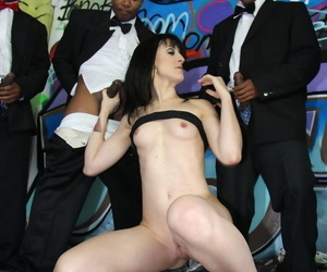 Dark haired female Dylan Ryan gets on her knees for a blowbang with black men