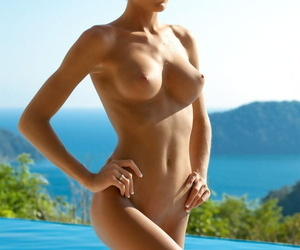 Attractive blonde Eliza Carson vaunts her big fake tits in the great outdoors