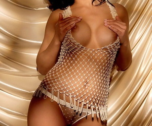Raven haired model with fake tits Tiffany Fallon showing her curves
