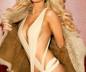 Attractive blonde Tiffany Toth takes off her coat and flashes her boobs