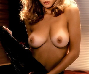 Glamorous playmate Gwen Hajek displays natural big tits in erotic photo shoot