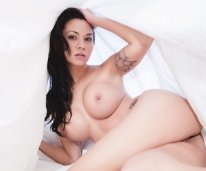 Tattooed Asian girl Jennie Reid strips and takes hot selfies in her bed