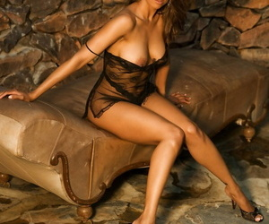 Stunning centerfold babe Stacey Dash models her medium tits in sexy locales