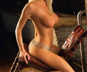 Impressive centerfold Mandy Ashford vaunts juicy fake tits anent dispirited settings