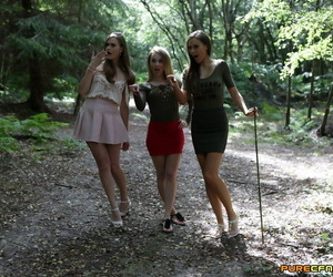 College girls come down with a suppliant fated near a tree nigh the woods with an increment of swell up his unfurnished dig up