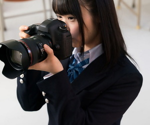 Japanese schoolgirl puts down her camera long enough to suck off her teacher