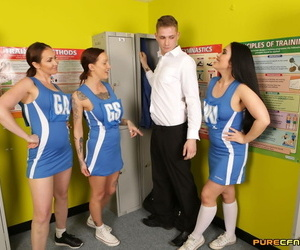 A group of cheerleader strip and jerk off a boy in the locker room