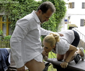 Fully clothed women get pissed on after a threesome fuck on picnic table