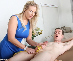 Older blonde babe Angela Allwood ties up a clients cock during a happy ending