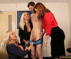 Clothed women jerk and suck off a fellow employee at work