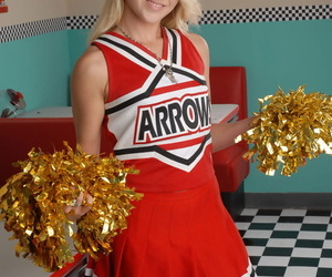 Cute blonde Tegan Summers models non nude in her cheerleader uniform