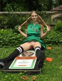 Amateur girl Hannah Hawthorne doffs cheer attire before a corncob insertion