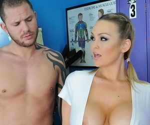 Busty cheerleader Abbey Brooks gives a titjob and gets fucked