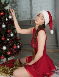 Adorable teen Angela makes her nude modeling debut in a Santa hat at Christmas