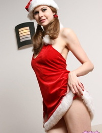 Amateur girl Olivia Eden cradles her tits in Christmas attire during a SFW set