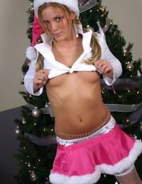Amateur girl Karen flashes upskirt panties in Xmas attire afore the tree