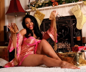 Mature brunette Danica Collins uncovers her large breasts at Christmas