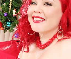Fat girl with red hair April Flores toys her twat with a candy cane at Xmas