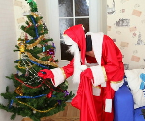 Flaxen-haired teen gets banged at the end of one\'s tether a masked suppliant up a Santa Rectification suit