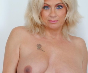 Hot blonde Dimonty drops her dress to expose her mature saggy boobs & spread