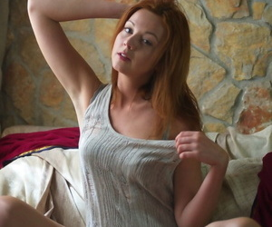 Flighty redhead Elen Moore knows how to pose in bed butt naked