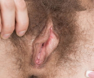 Dark haired Efina gets some hot pussy licking and hairy beaver toying close up