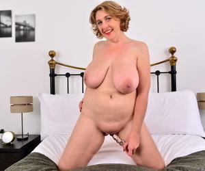 Mature BBW Camilla Creampie toys her pink pussy after baring her huge boobs