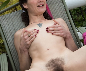Over 30 hirsute woman Amber S parts her hairy cunt with red fingernails