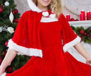 Cute teen girl doffs her Christmas outfit for nude posing over the holidays
