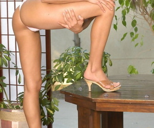 Sexy solo girl Addison finger spreads her pussy after getting naked on a table