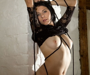 Pitch-black haired catholic Bella T manages to masturbate as A she entwines in the flesh in rope