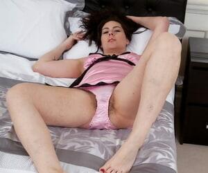 Brunette chick Sharlyn dildos her moist beaver in satin lingerie