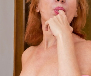 Hot older woman Silvia plays with her vagina after getting undressed