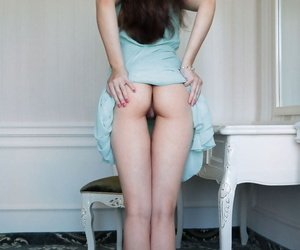 Teen solo girl Caroline shows off her assets underneath long dress
