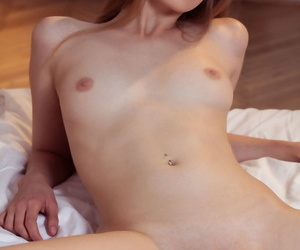 Pretty Bretona lifts up her short skirt and her legs for a closeup pussy shot