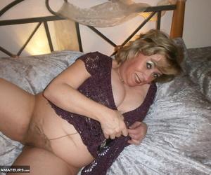 Horny old granny Caro bares saggy fat bosom & hairy pussy closeup approximately pantyhose