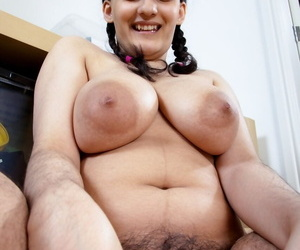 Hirsute brunette Riani uncovers her big natural tits after playing with Lego