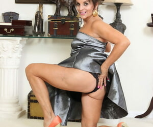Over 30 female Nicole Newby parts her pussy lips after removing a silver dress