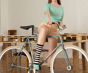 Flat chested teen Foxy bares her tight ass and slit in striped socks